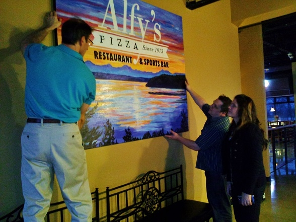 hanging painting with Owner of Alfys!