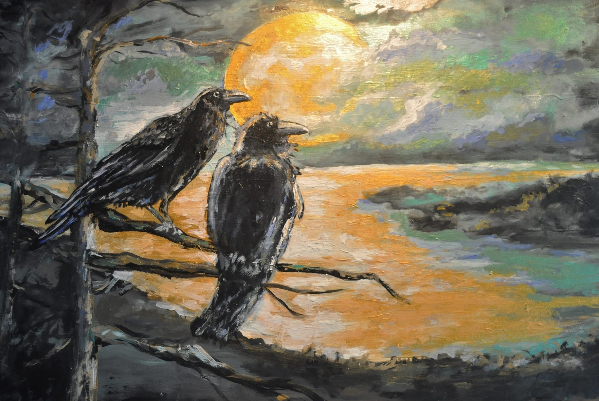 A pair of Ravens in the light of a full moon.